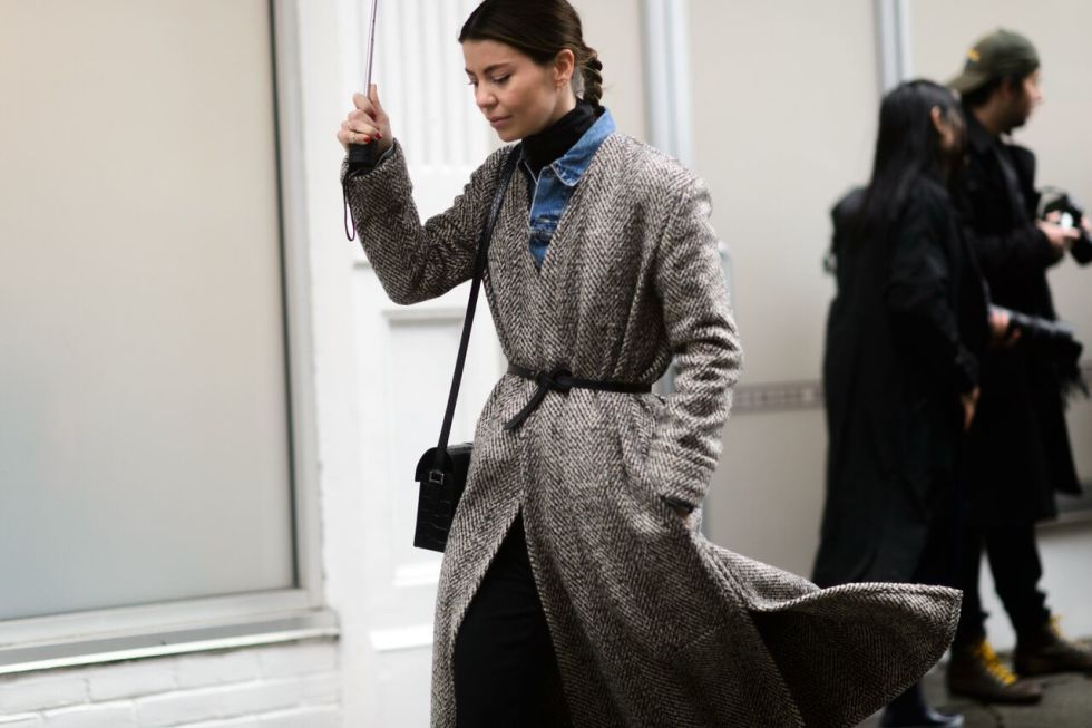 If you're worried about looking too bulky under all of your layers, throw on a belt over your coat to define your waist.