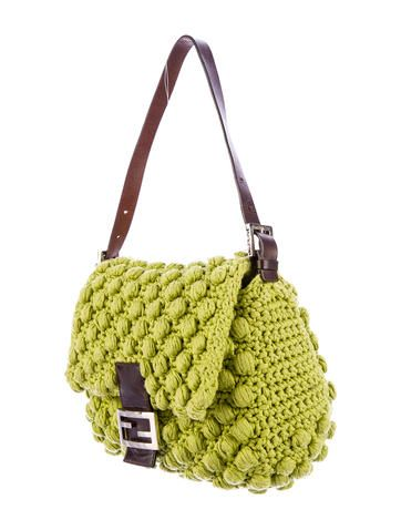 Green knit Fendi Crochet Mama shoulder bag with dark brown leather trim, silver-tone hardware, flat adjustable shoulder strap, satin interior lining, interior zip pocket and front snap closure at front flap. Shop Fendi designer bags online at The RealReal.