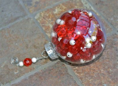 GREAT ornament idea with extra left over beads from DIY jewelry!  The beads can get changed for different themed trees each year if you'd like!