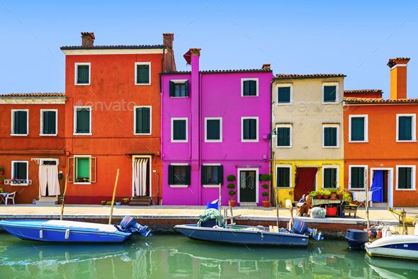 Venice landmark, Burano island canal, colorful houses and