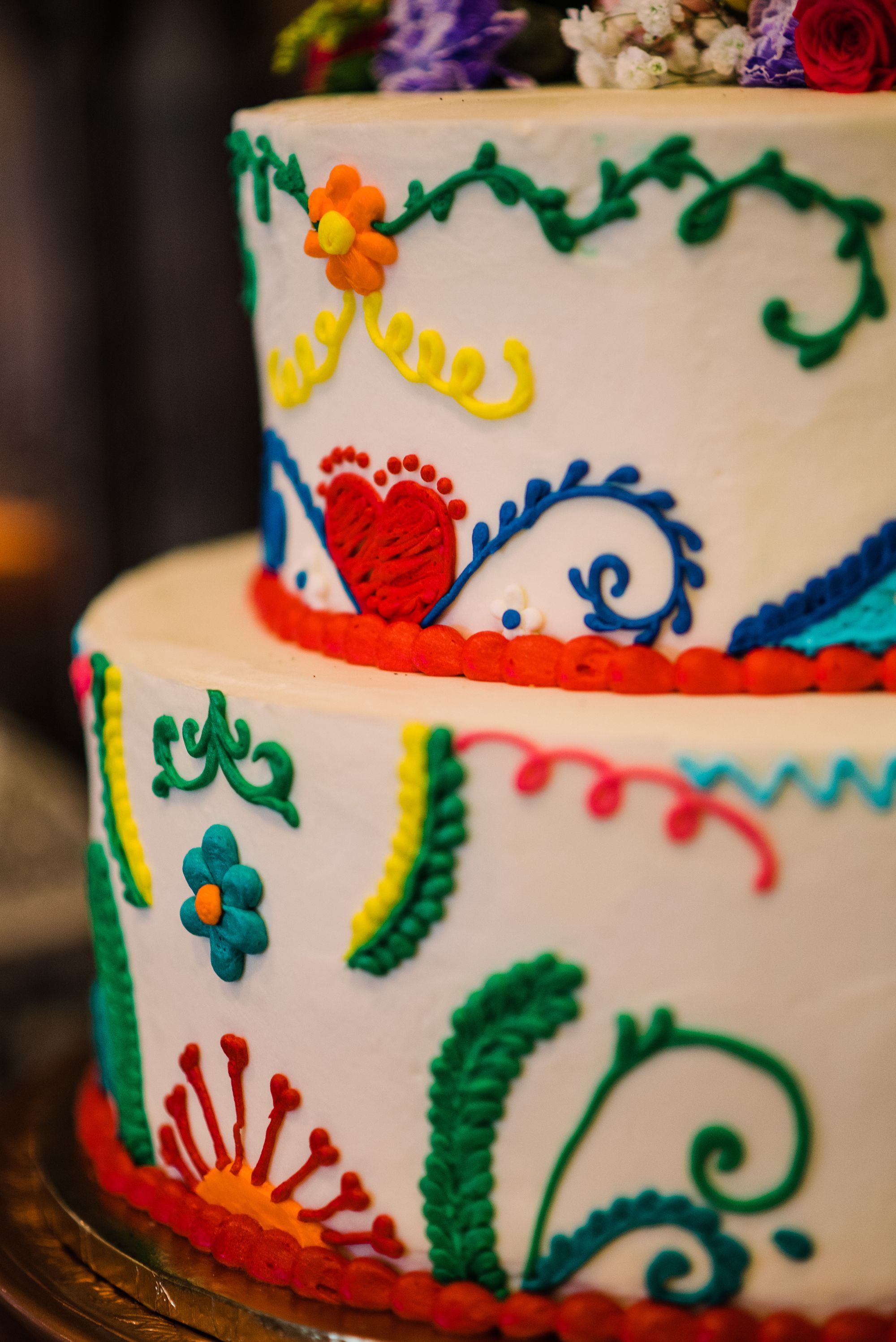 ⁠A colorful and fun fiesta-inspired Wedding cake⁠. ⁠  📷 Freeze Frame Photography