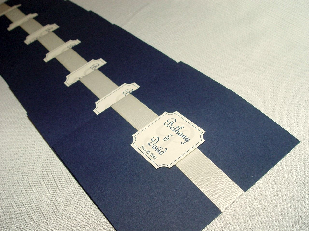 The Katherine - Unique Gatefold Wedding Program - Satin Ribbon Band. $3.00, via Etsy.  **Shown in smooth navy with silver satin ribbon and navy printing**