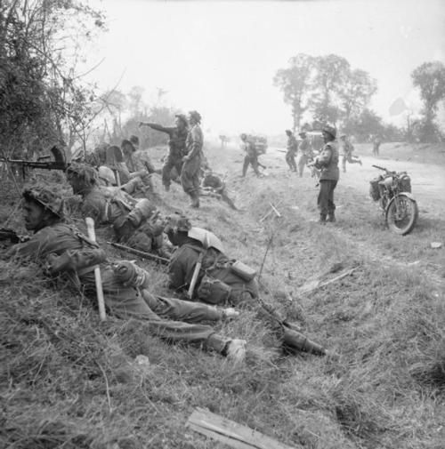 Soldiers of 1st Welsh Guards in action near Cagny. rw