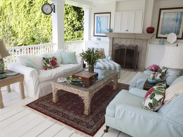 pretty porch...love the fireplace!