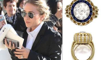 Mary Kate's Cartier engagement ring. The four-carat sparkler, which the fashion designer was seen sporting at Paris Fashion Week yesterday, was purchased at a Sotheby's jewelry auction for a cool $81,250, according to Stylecaster.