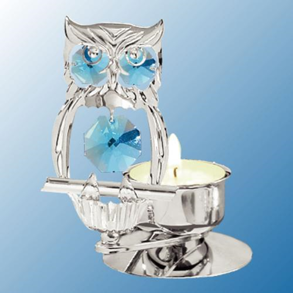 Hootie's Tealight Candle Holder - Swarovski Crystal Elements  -- He's a Hoot and he will entertain you as his gorgeous crystals catch the light from your room and the tealight candle. This owl is finished in brilliant chrome plating, and his crystals are Swarovski elements. All for your pleasure and for your pleasure in gifting Hootie to friends and family.