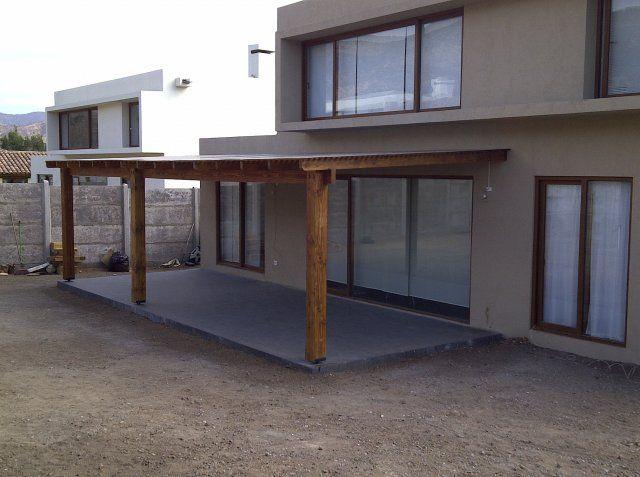 Terraza deck piedra roja quinchos para asados for Construccion de casas en terrazas