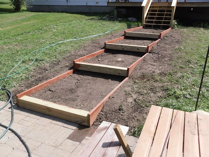 How to build steps on a slope willamette house pinterest sloped backyard backyard and for Massachusetts building code exterior stairs