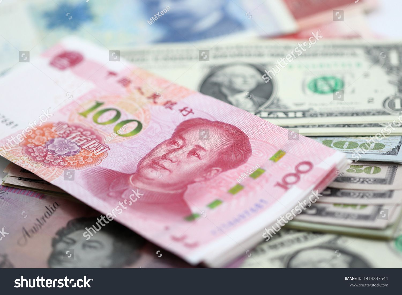 100 china yuan stack over us dollar bill norway krone