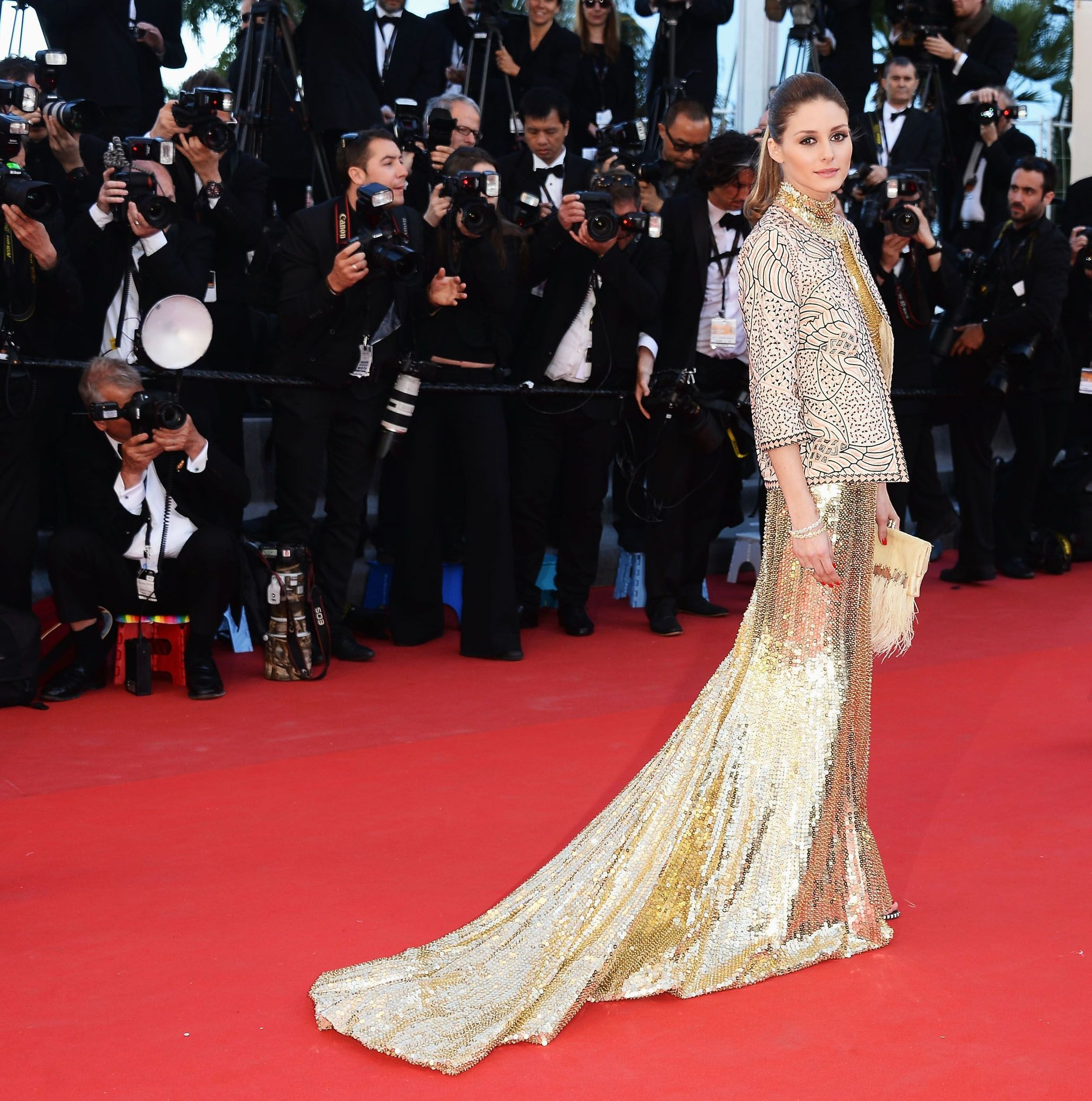 Olivia Palermo was a golden beauty in her #RobertoCavalli gown at 'The Immigrant' premiere tonight in Cannes! #CavalliatCannes