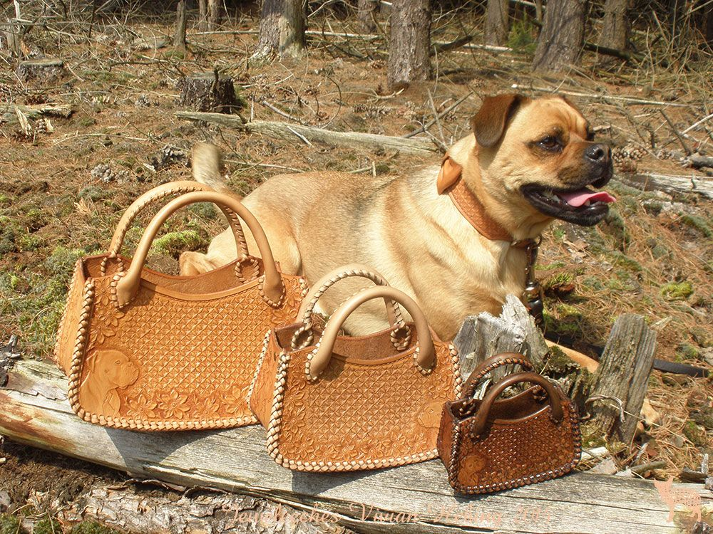 Jeweleeches Vivian Hebing handmade leather, made three leather handbags with our boxer Mr. Roger, showed by our dog Sjeff! <3