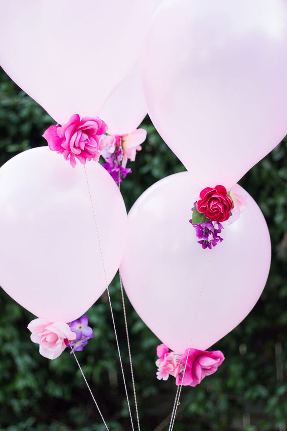 wedding centerpieces fake flowers%0A Need pretty decor in a pinch  Give a bunch of balloons an extra oomph by