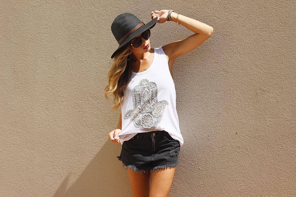 Blogger Babe @ashleybrooke_ wearing the Knot Back Hamsa Tank. Style #C6889.