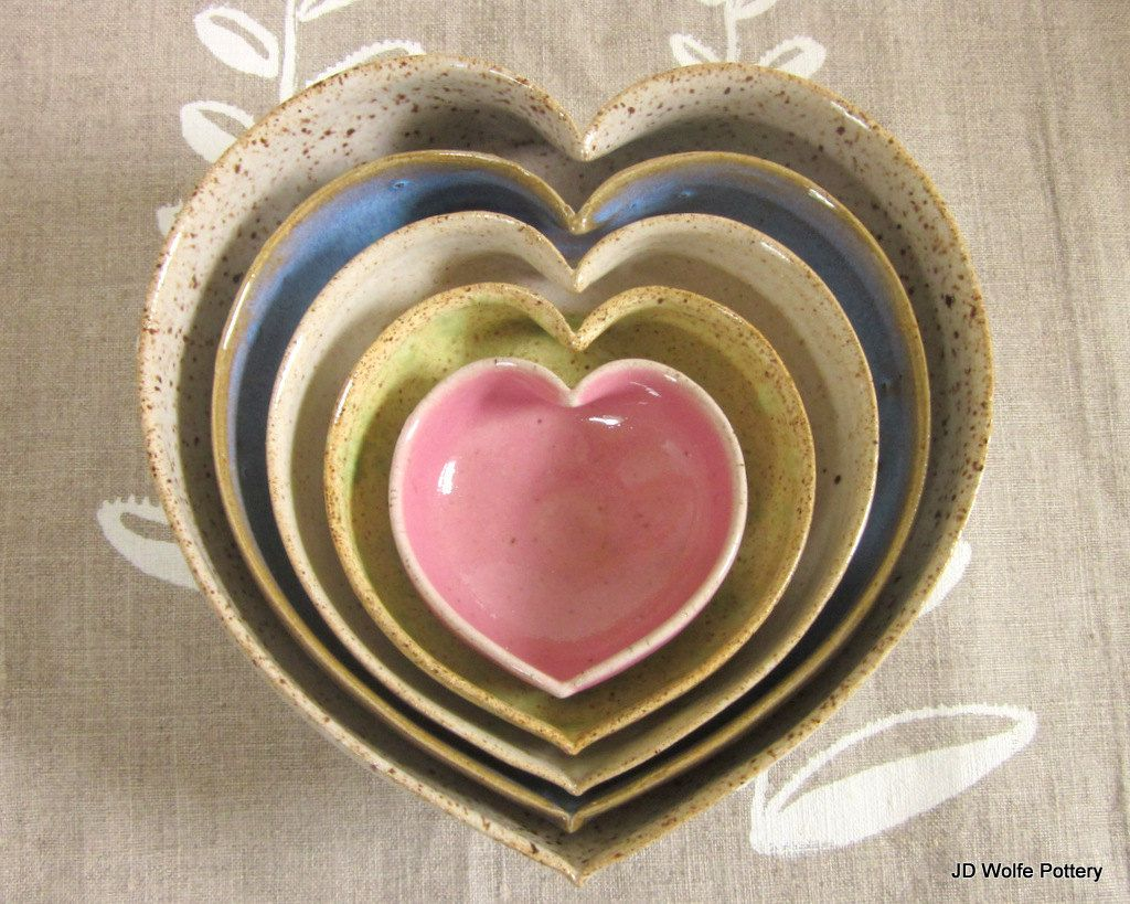 I want these for my kitchen! made to order - nesting ceramic  heart bowls - multi colored - 5 inches. $60.00, via Etsy.