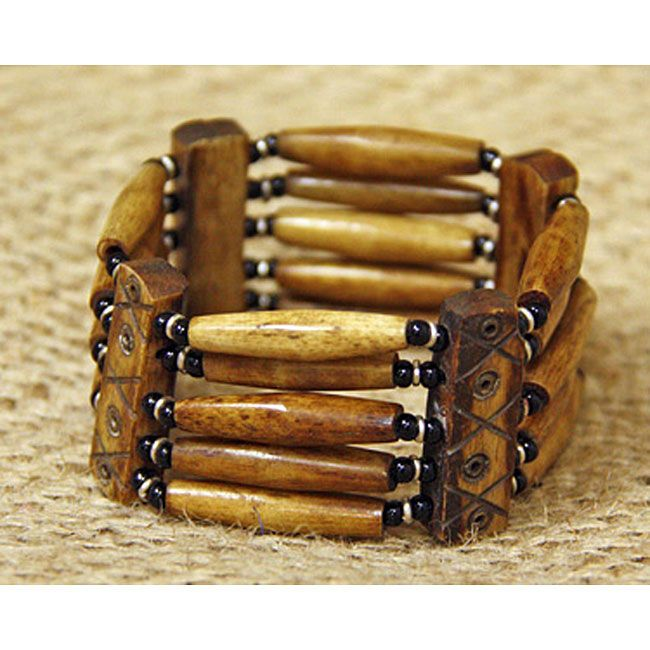 This stretchy bracelet is made of hand-carved cattle bone beads, mud-dyed in a centuries-old tradition. Handmade glass beads reflect another revered, traditional African art form in jewelry-making.