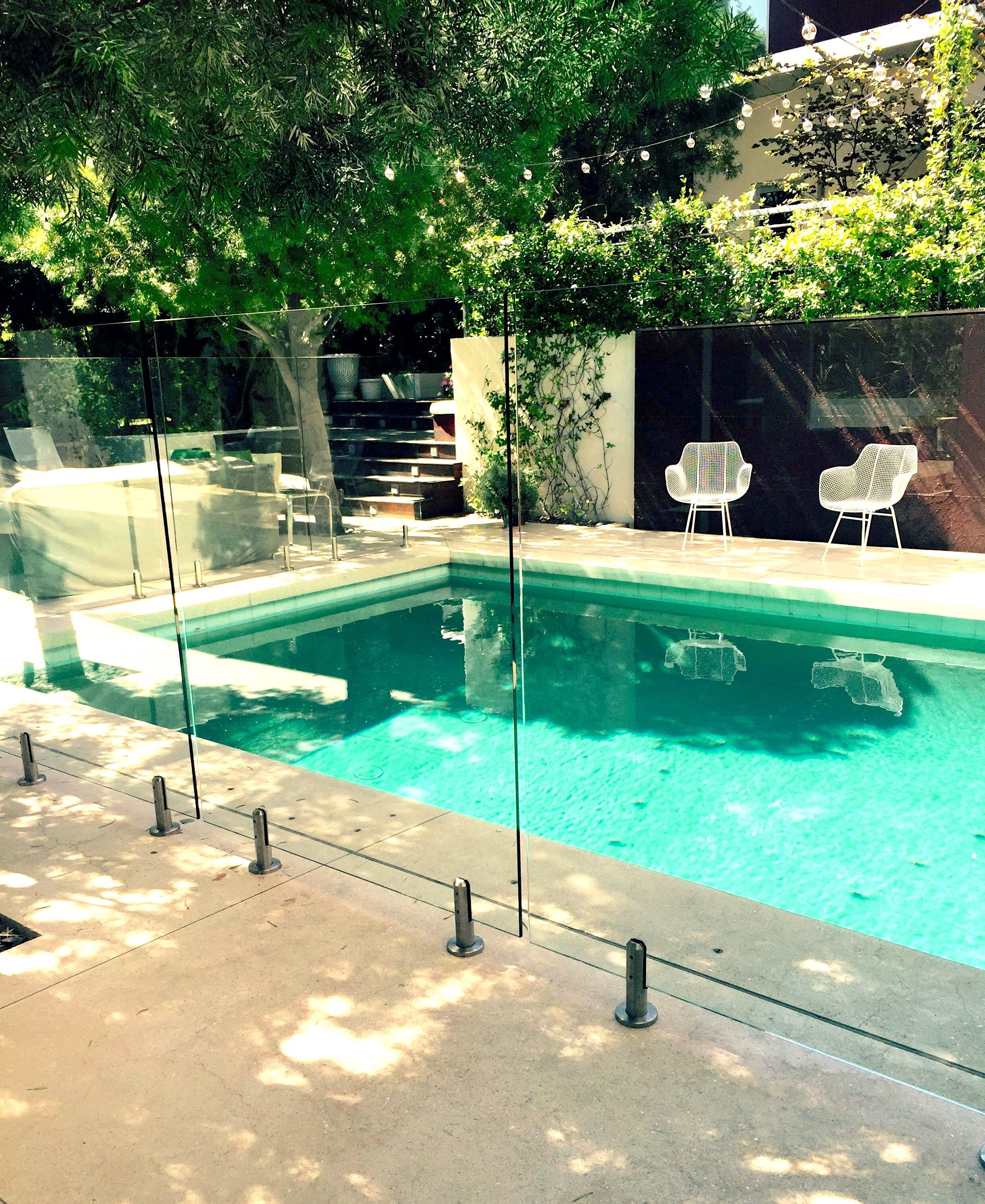 A Glass Pool Fence Is Perfect For Small Backyards Great Way To Maximize Your Space Pool Fence Glass Pool Fencing Pool Safety Fence