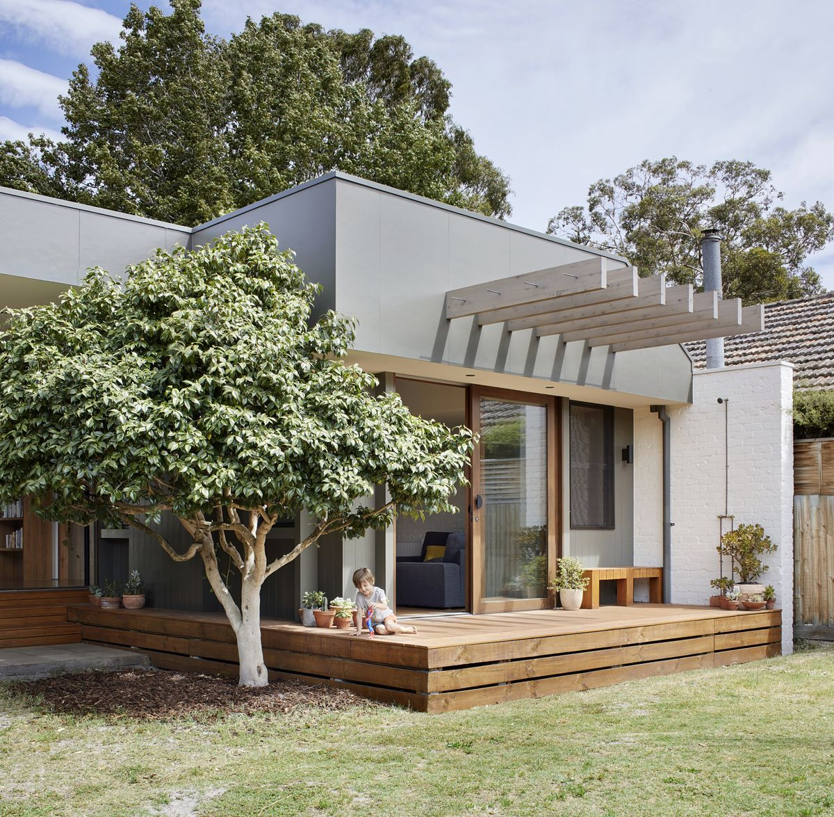 Modern Home Additions: A Courtyard Deck's The Perfect Way To Combine Old And New