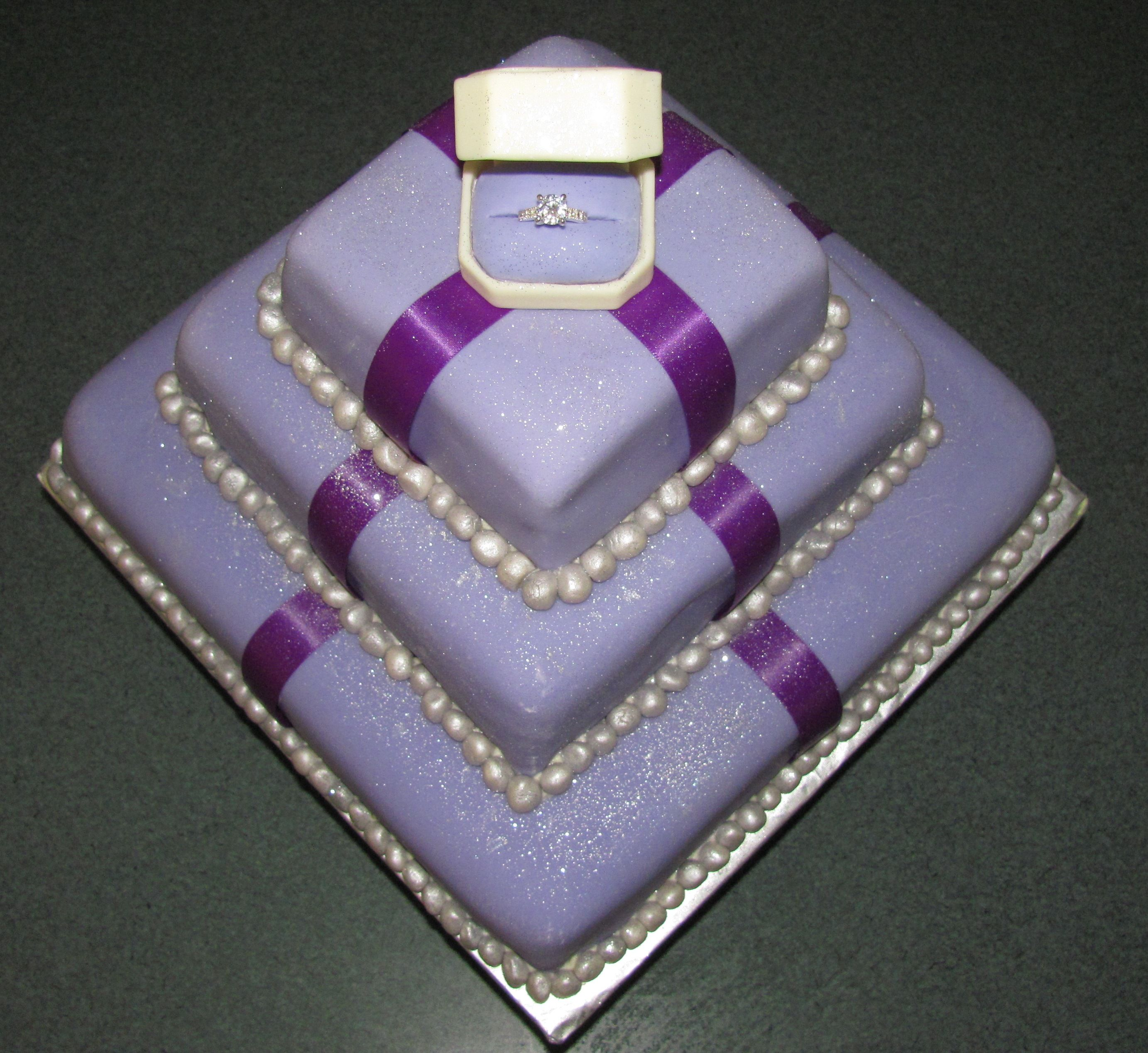 fondant covered engagement cake, ring box is made of white ...
