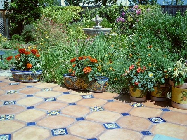 mexican paver tiles inset with blues and patterns give this patio a very high class - Outdoor Patio Tile Ideas