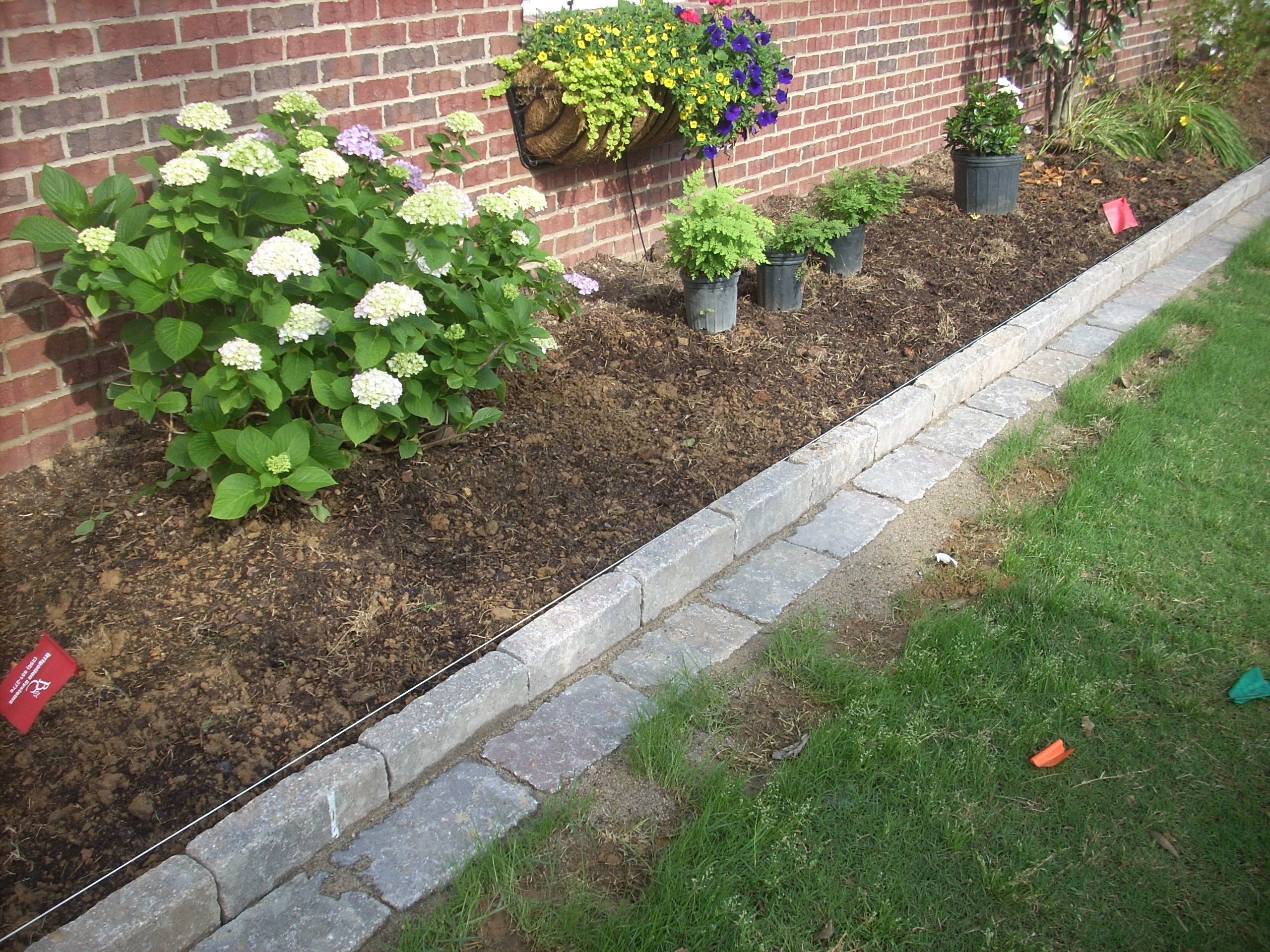 Let 39 s talk about rock edging around flower beds theses for Brick edging for your flower beds