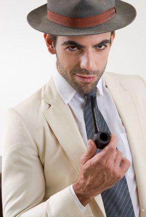 Ivory suit jacket, fedora, pipe