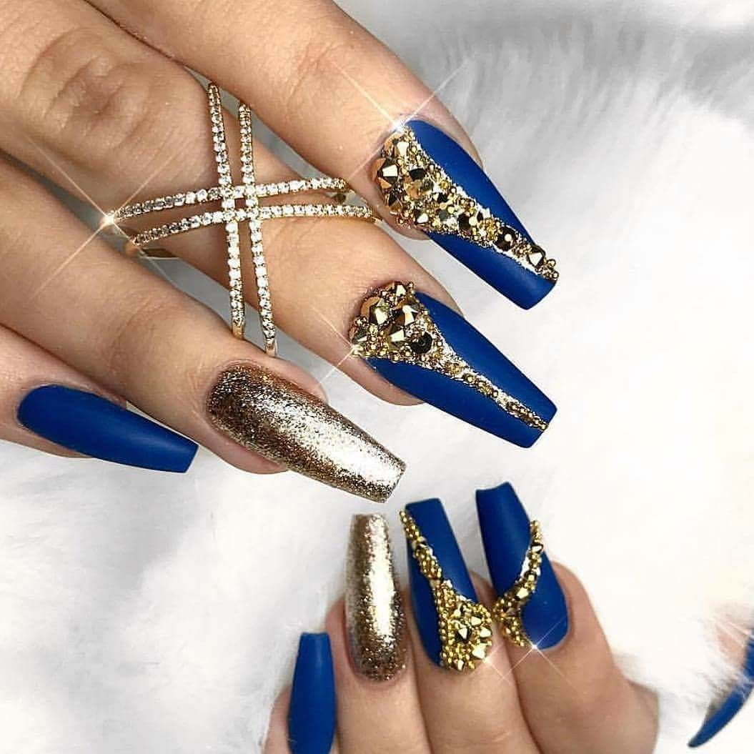 beautiful royal blue and gold nails!   hit the nail on the head