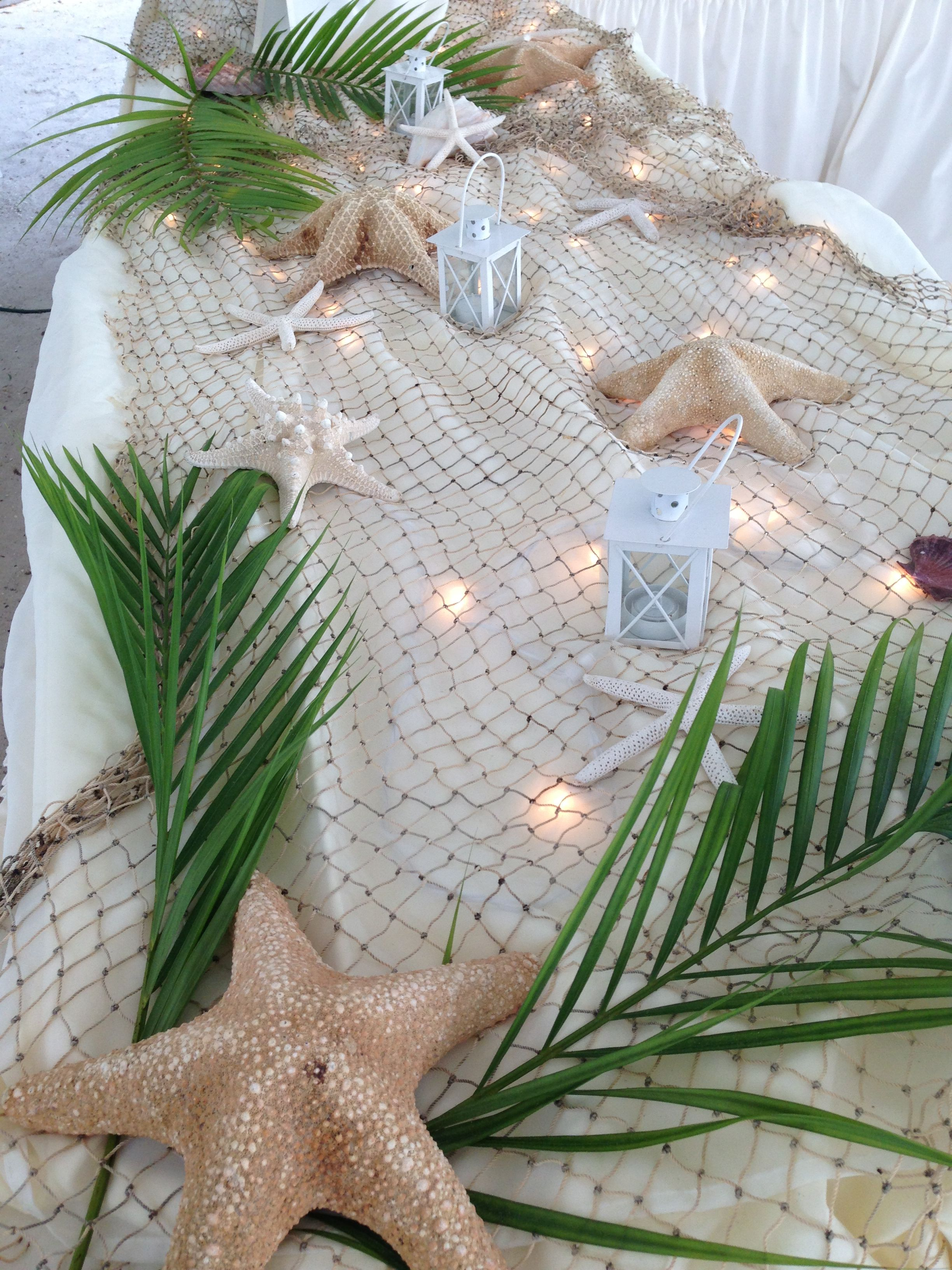 Starfish island buffett table decor beach weddings for Net decoration ideas