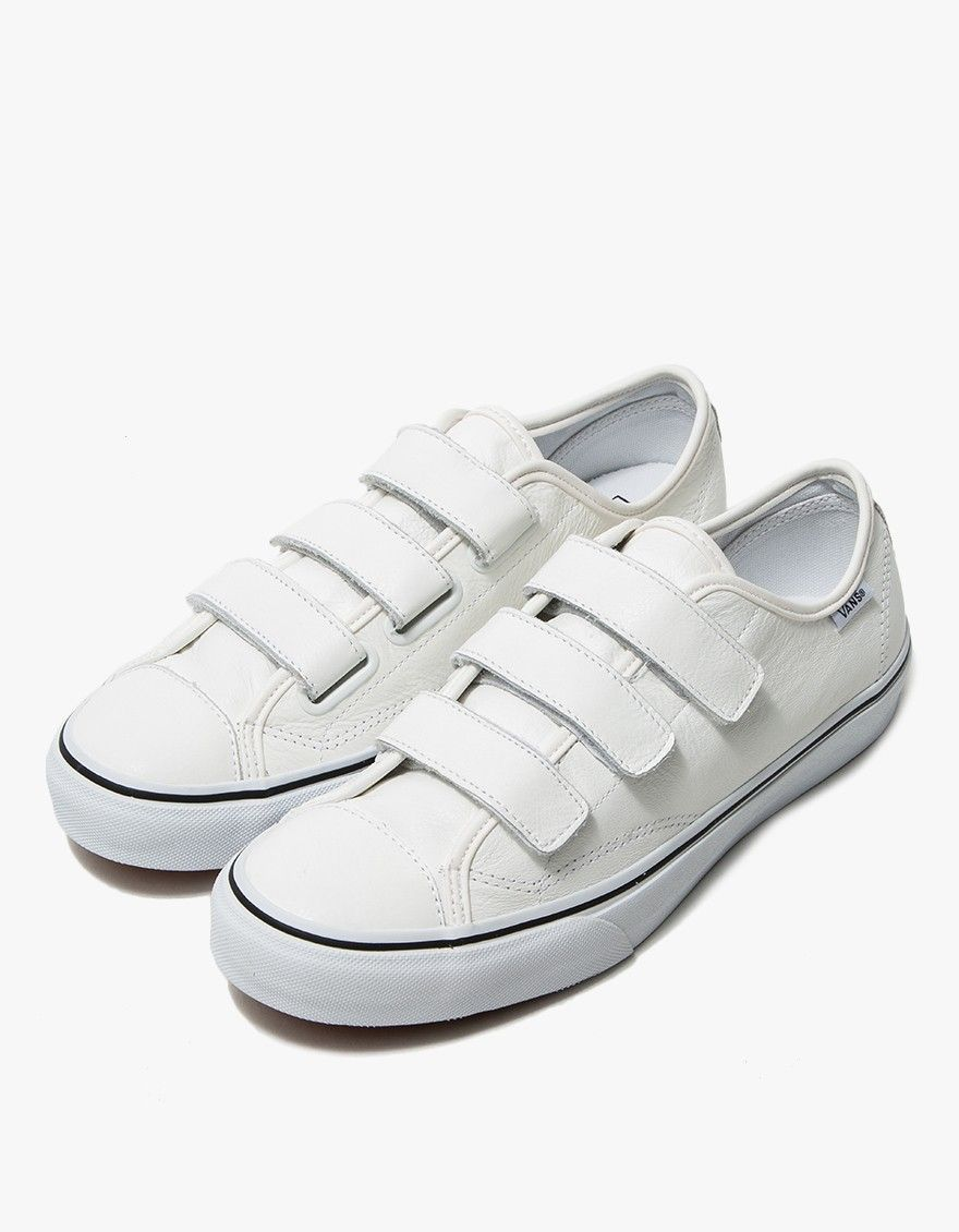 c673c0ad31 Retro-inspired sneaker from Vans in White. Textured leather upper. Three  strap Velcro