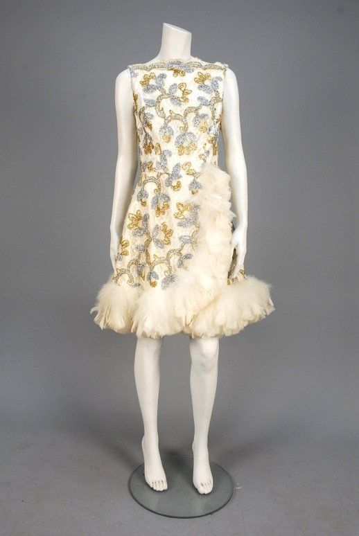 Lot: LACE and METALLIC COCKTAIL DRESS with FEATHER TRIM,, Lot Number: 0754, Starting Bid: $70, Auctioneer: Charles A. Whitaker Auction Co., Auction: Couture & Textiles from Museum Collections, Date: April 16th, 2016 CDT