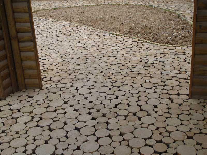Terrasse en dalle de rondins d 39 eucalyptus jardin for Peinture sol terrasse