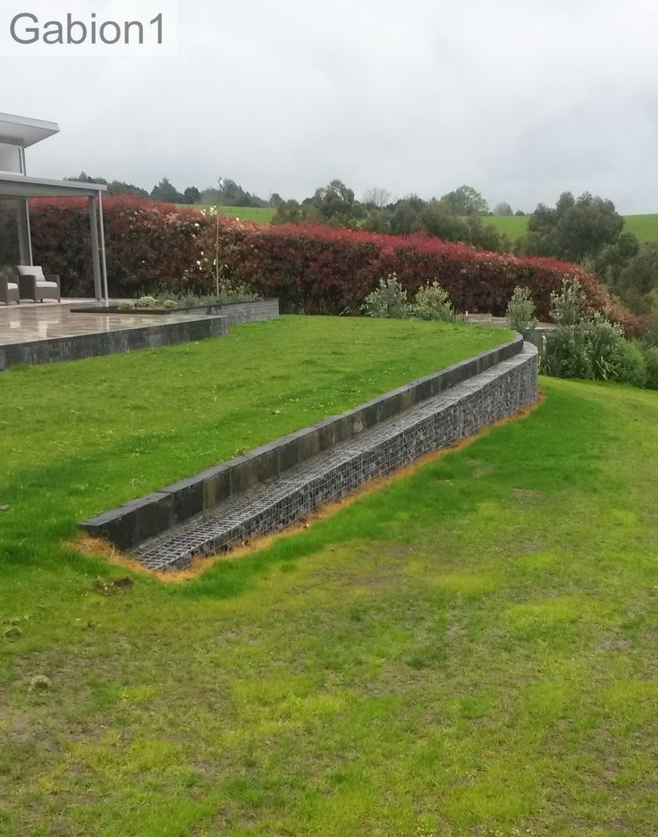 Curved Gabion Wall With Basalt Stone Capping Blocks Http Www Gabion1 Co Nz Landscaping Retaining Walls Gabion Wall Sloped Garden