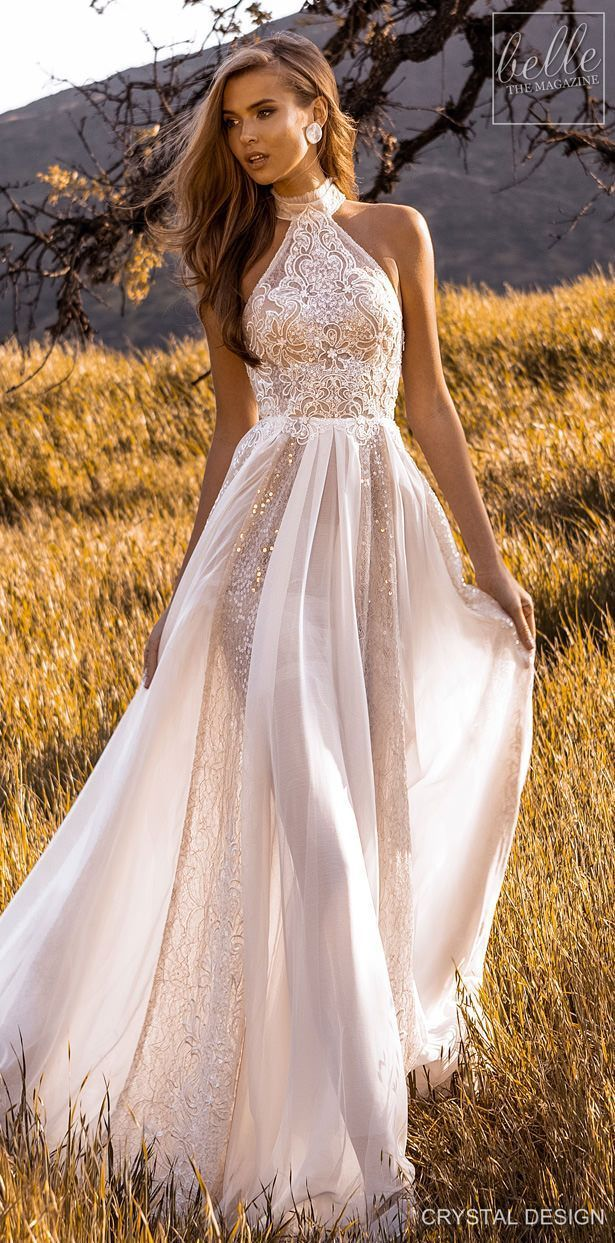Crystal Design Couture Wedding Dresses 2020 - Catching The Wind Collection - Ibiza   Shimmery lace a-line wedding dress with halter sleeveless neckline , hich neck and flowy skirt See more gorgeous wedding dresses by clicking on the photo boho wedding dresses Crystal Design Couture Wedding Dresses 2020
