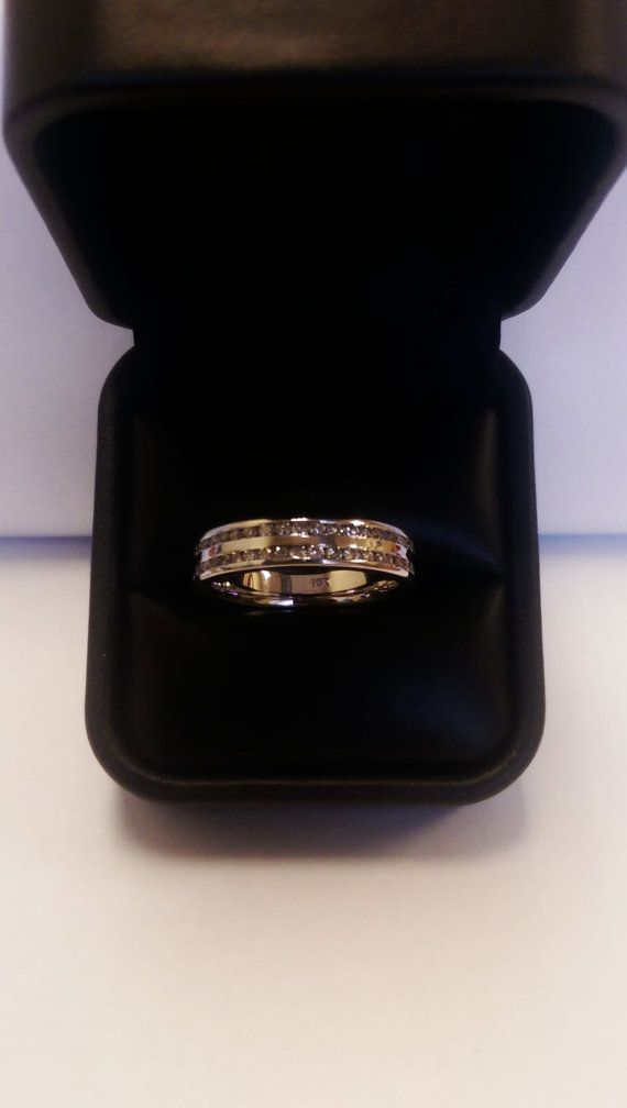 This men's ring is truly special ! There are two circles of diamonds on this ring. The ring is in 14K white gold with 1.80 ct Diamonds and it has the grand look of a gorgeous wedding band as well as the stylish look of love. The band weighs 6.91 grams and comes in an elegant gift box and is guaranteed to be authentic. Enjoy this stunning men's band ! $1245