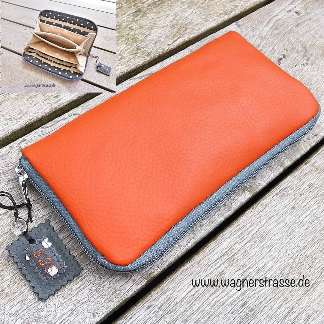 Awesome purse made of orange vegan leather, revolving zipper in grey. Inside you find a coin case with zipper, 6 card slots, and 4 partitions made of three different kind of fabric. This beautiful purse is part of orange spring collection from wagnerstrasse http://www.wagnerstrasse.de https://www.amazon.de/handmade/wagnerstrasse #crazyforpurses #handmadeatamazon #vegan #portemonnaie #geldbeutel #fashion #orange #grau #grey #fächertasche