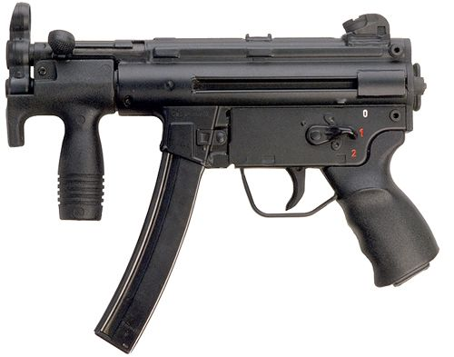 """A """"faux"""" Heckler & Koch MP5K - this is an original SP89 pistol converted to full auto fire by a Class III armorer. Giveaways are the lack of a paddle magazine release. This version was also used in movies between 1989 and the late 1990s when factory original MP5Ks were not available - 9x19mm."""
