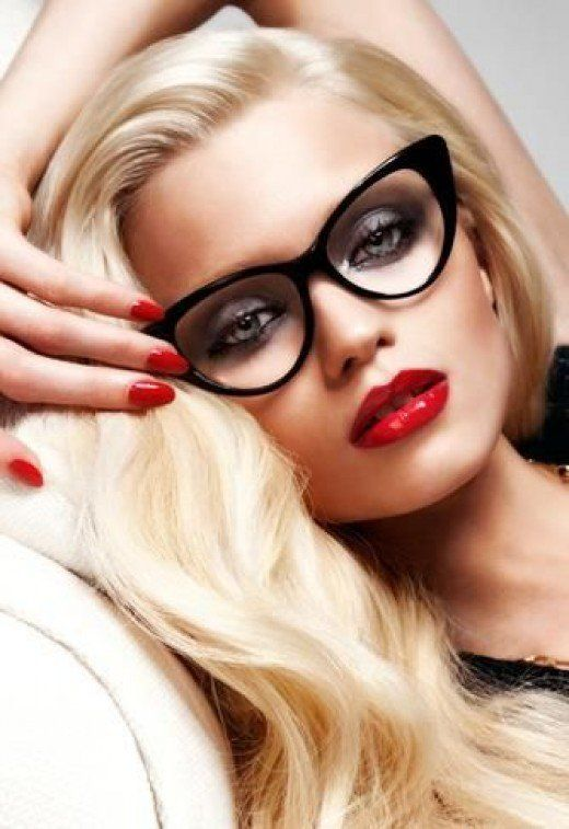 49772dc596 Beautiful blonde bombshell in retro black cat eye glasses and bold red  lipstick