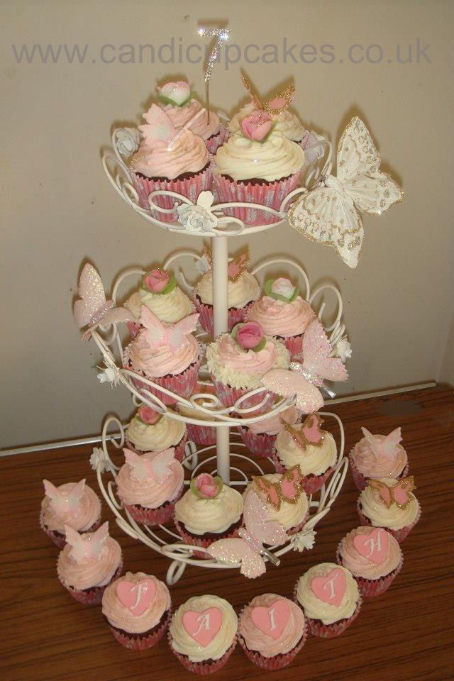 Bespoke birthday cupcakes with embossed hearts and butterflies.