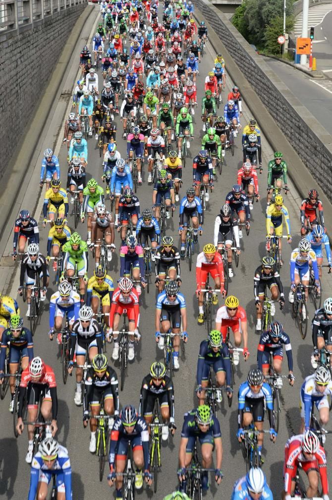 The colourful sight of the peloton leave Liege