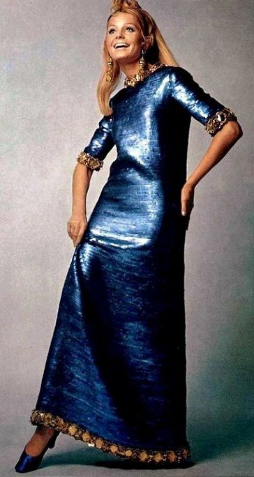 Kecia Nyman is wearing a shimmering sapphire blue dress by Christian Dior, 1967