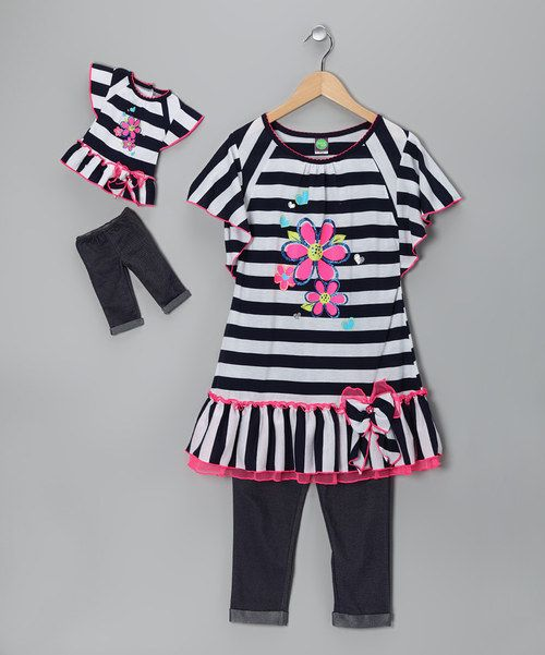 It'll be next to impossible to have anything less than the best day ever with this ruffle and polka dot-adorned set in the mix. A matching outfit for Dollie makes the fun even more infectious.Includes dress, leggings and doll outfitDoll outfit fits 18'' dollDress: 100% polyesterLeggin...