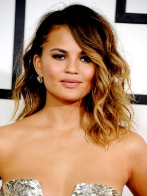 CHRISSY TIEGEN Perhaps inspired by Cara Delevingne's punk rock hair at last year's Met Ball, the gorgeous Mrs. Legend balanced a badass brai...