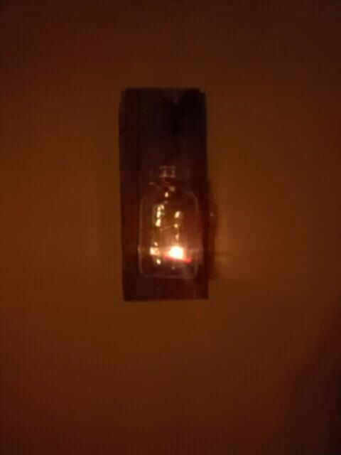 Cool candle made with a mason jar some aged wood and a