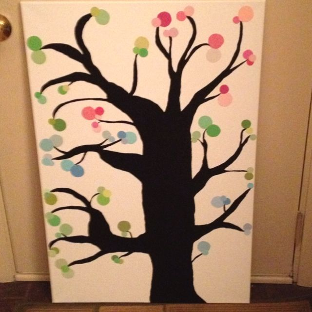 Black painted tree decorated with circles made from paint sample - sample cards
