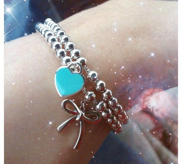 b1d9110d4 Tiffany bow bracelet and Tiffany heart bracelet. Arm candy ...