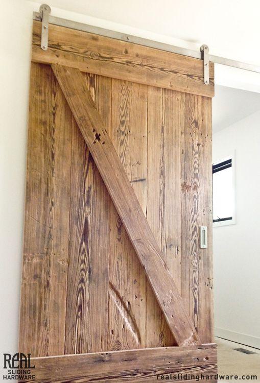 This Rustic Door Looks Great With The Stainless Steel Prop Hardware Kit Rustic Barn Door Hardware Barn Door Installation Barn Door Hardware