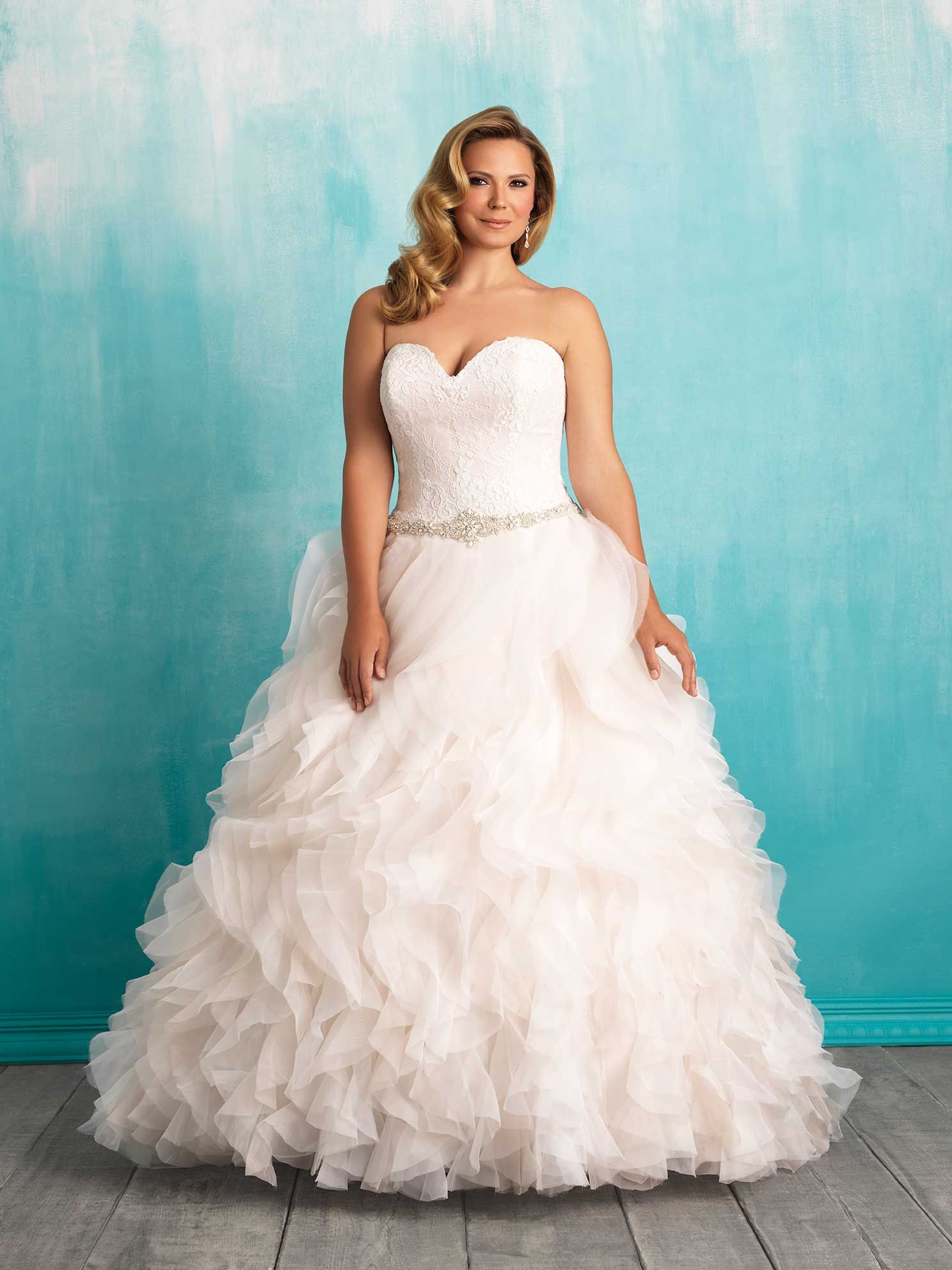 Lush layered ruffles compose the skirt of this strapless lace and ...