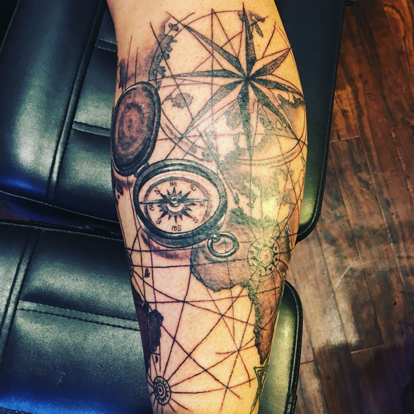 Compass And World Map Back Of Calf Tattoo