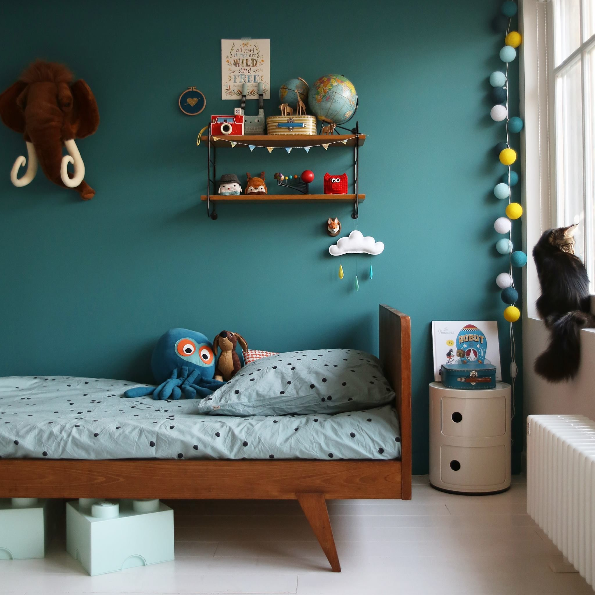 Moody Children Room With Beautiful Blue Wall And Some Vintage