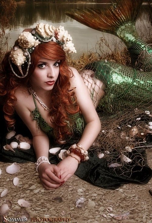 Mermaid with big hair piece.