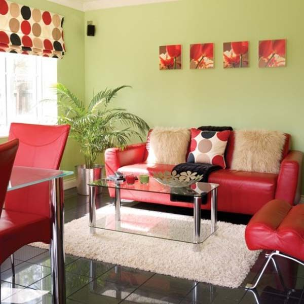 Room green living room decor with red sofa